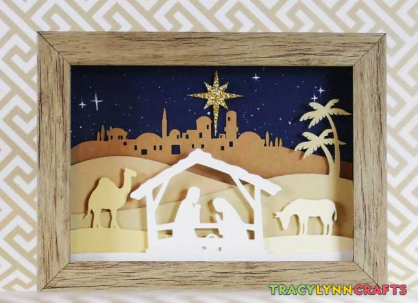The final cut paper nativity scene in the shadow box