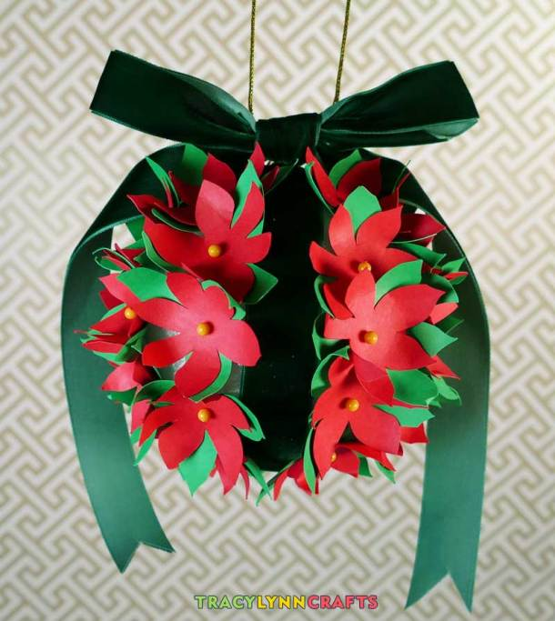 Add a ribbon and a decorative hanging strand to your poinsettia ball