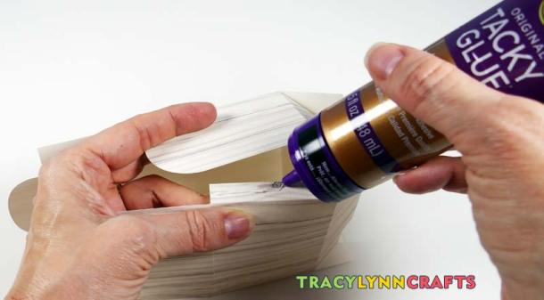 Glue the tab to the inside of the paper chest