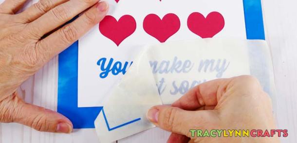 Remove the transfer tape from the shadow box heart art project surface
