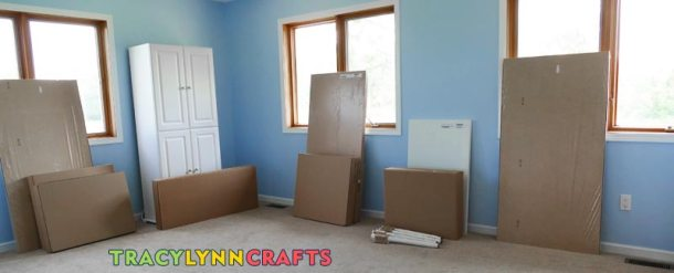 This is most of my IKEA furniture still in their boxes and set around the craft room