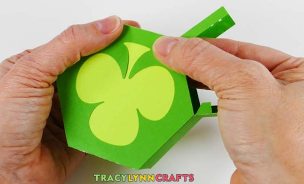 Open the door of the shamrock box and press the tabs into the top of the box