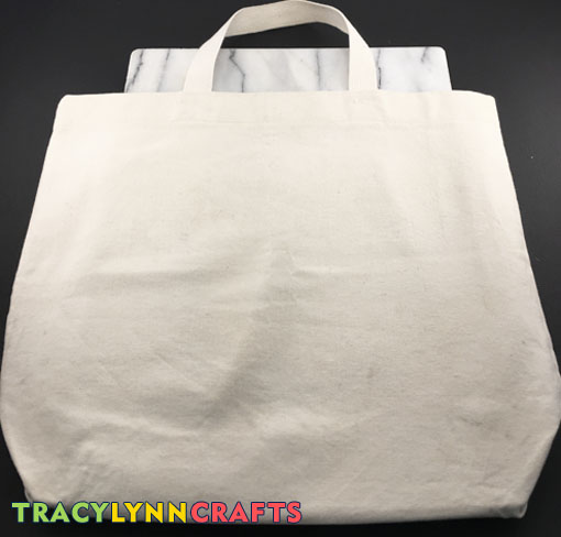 DIY Stenciled Tote Bag Insert a firm work surface into the bag