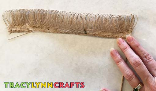 Lay florist wire on the burlap and start rolling