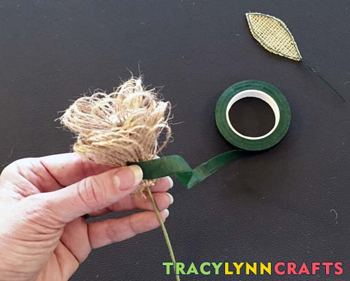Starting at the base of the burlap flower, start wrapping with the florist tape
