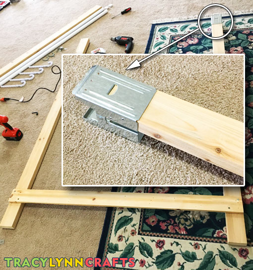 Attach sawhorse clamp to the tops of the legs