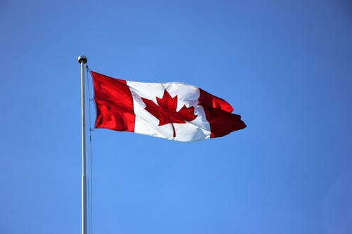 Canadian flag with blue sky background