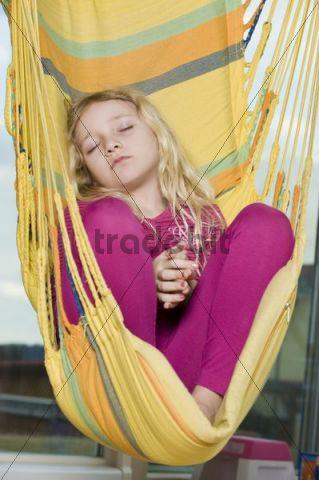 Girl sleeping in hammock chair  Download People