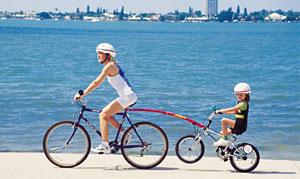Random mom towing kid on bike