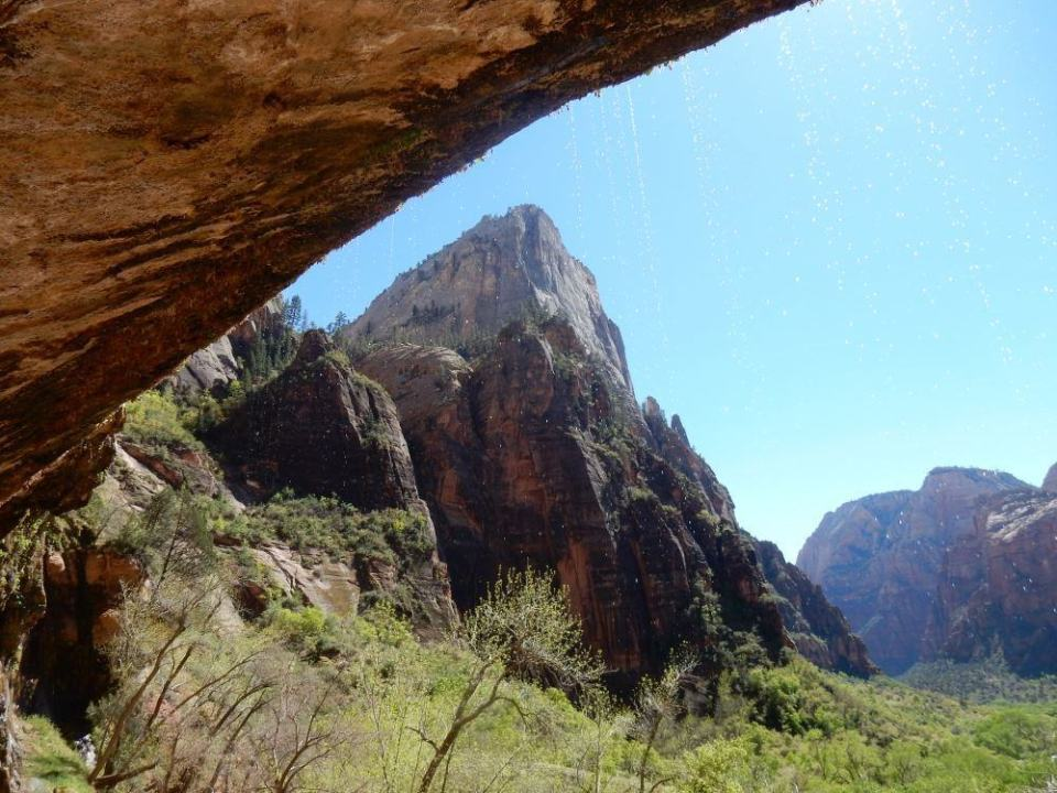 Under the weeping rock looking out at Zion National Park. Sights like these easily inspire a blog post.