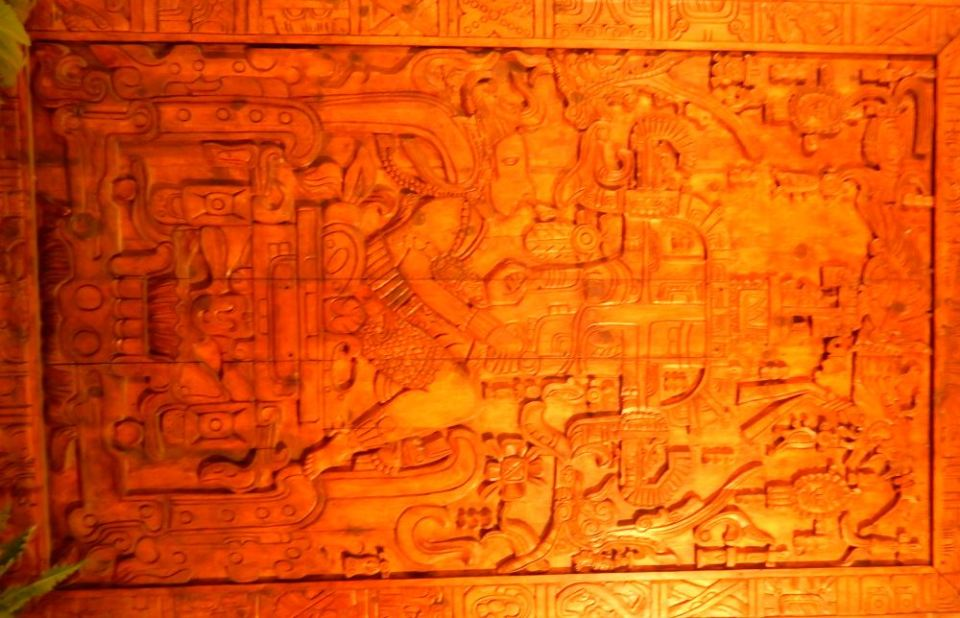 A reproduction in wood of a Mayan carving purported by some to depict a visitor from another planet.