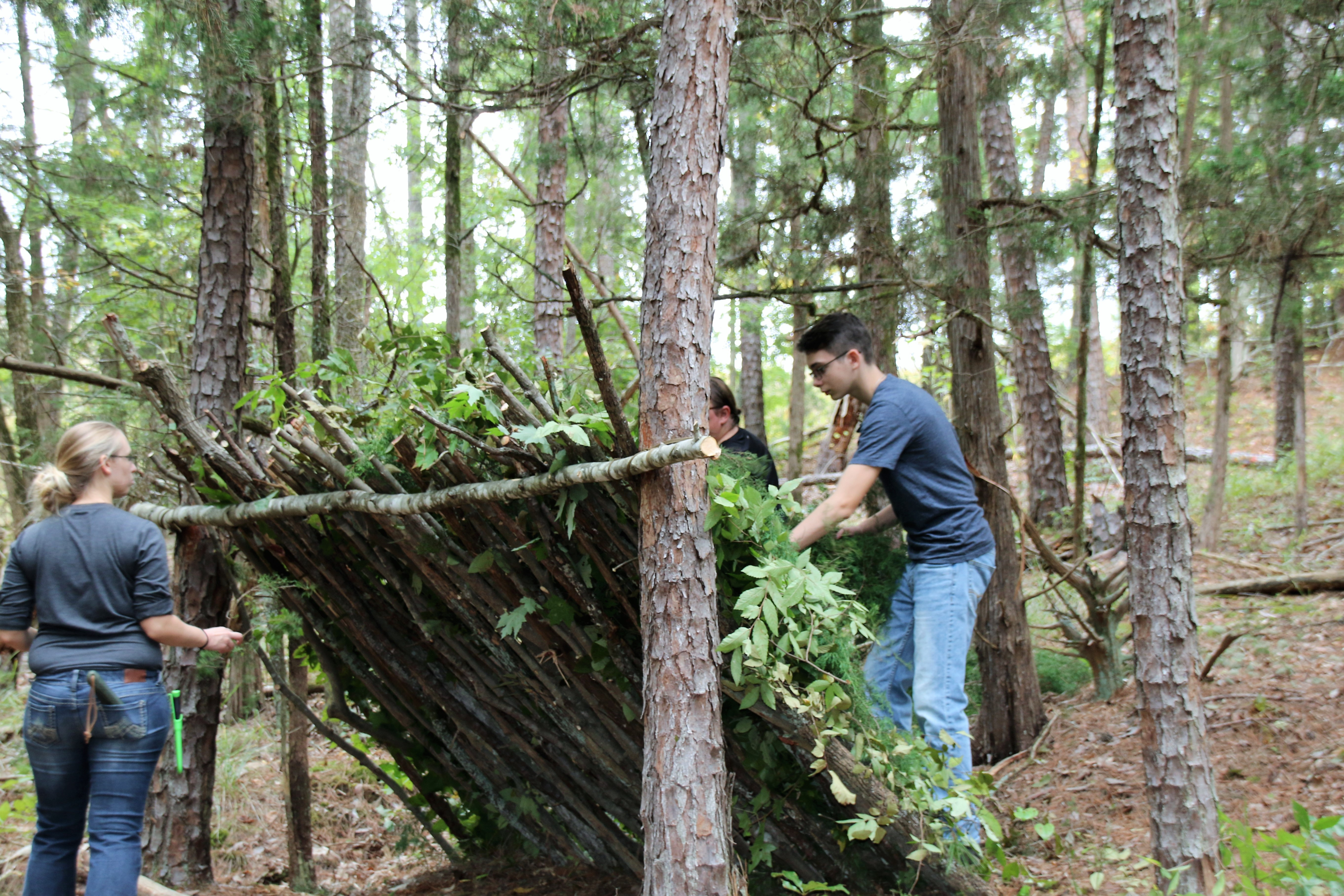 photo of campers building shelter