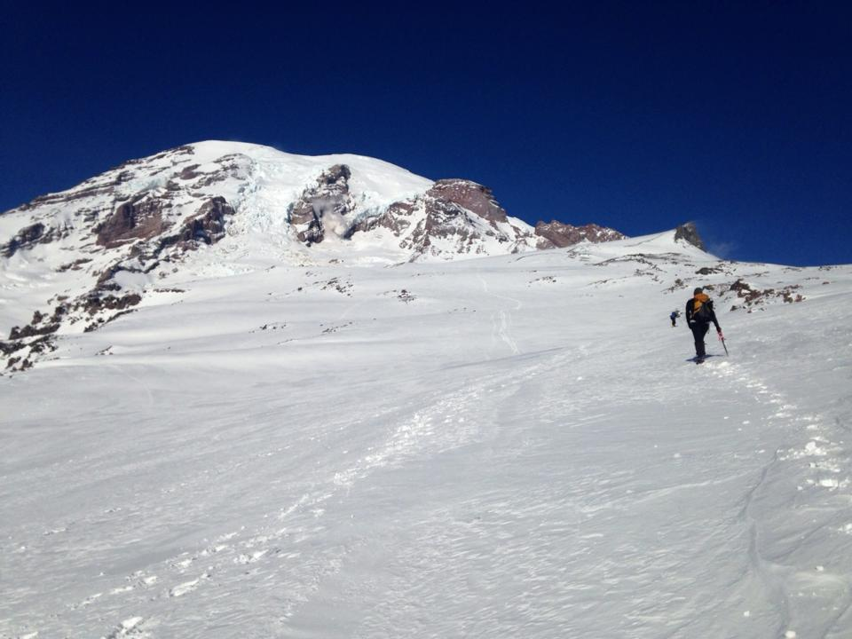 Heading up the Muir Snowfield. Mt Rainier's summit looks so close!