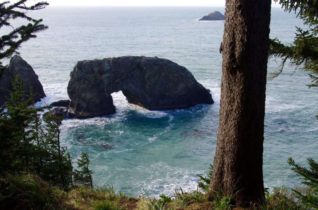A rock arch in the ocean.