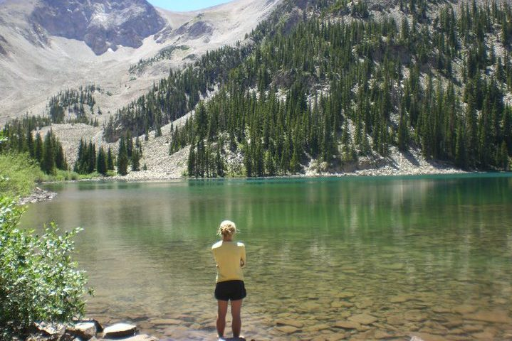 Ashley Arnold stands before Thomas Lake admiring Mt. Sopris looming above.