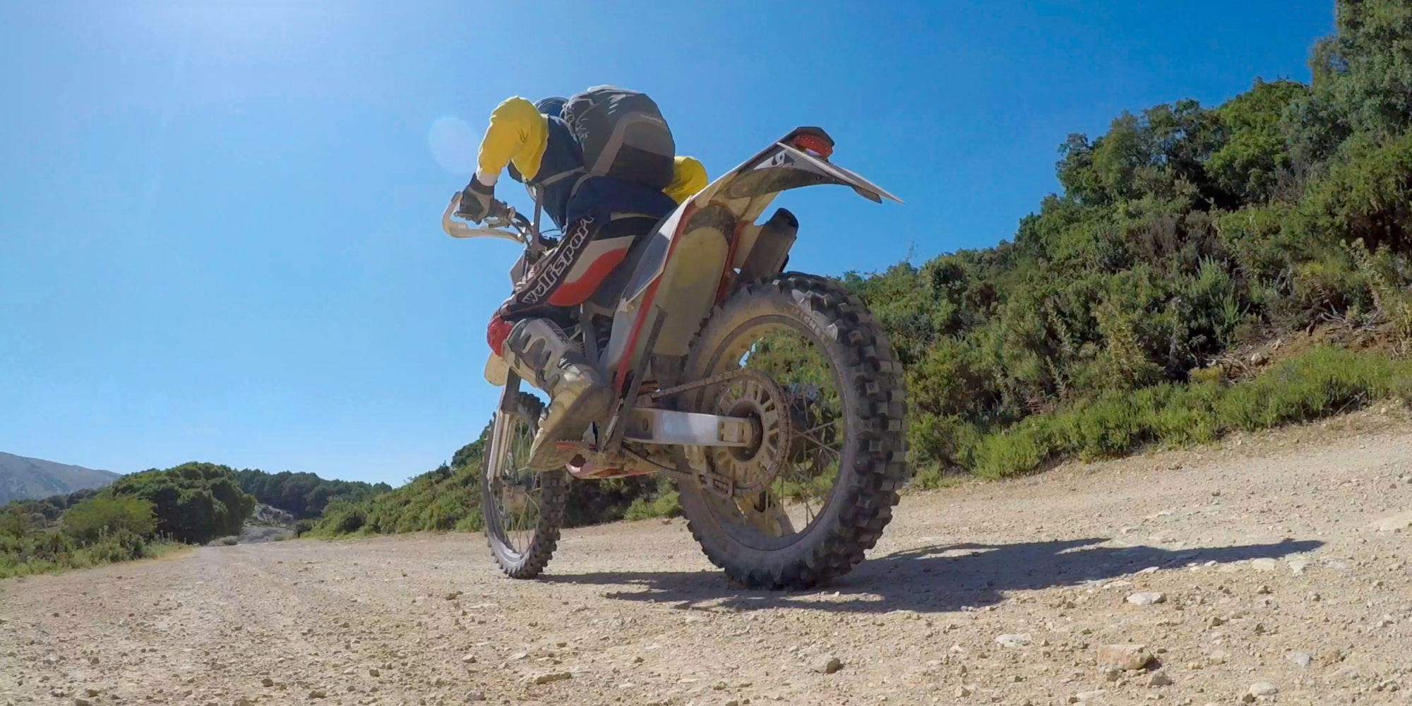 trail riding through miles of dirt roads, winding through mountain pass, ride through rock tunnels, traversing canyons and amazing rock formations in Spain