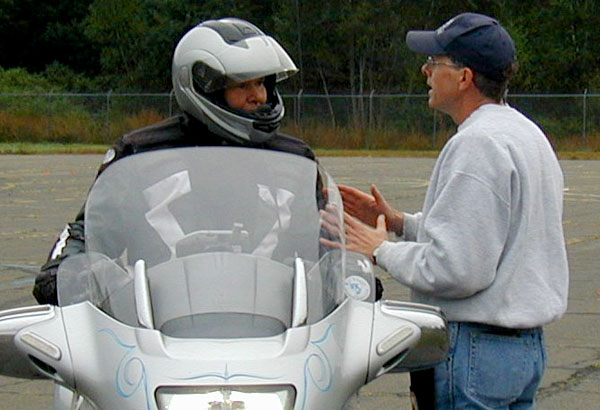 Ken Condon gives instruction to motorcycle rider during a safety course