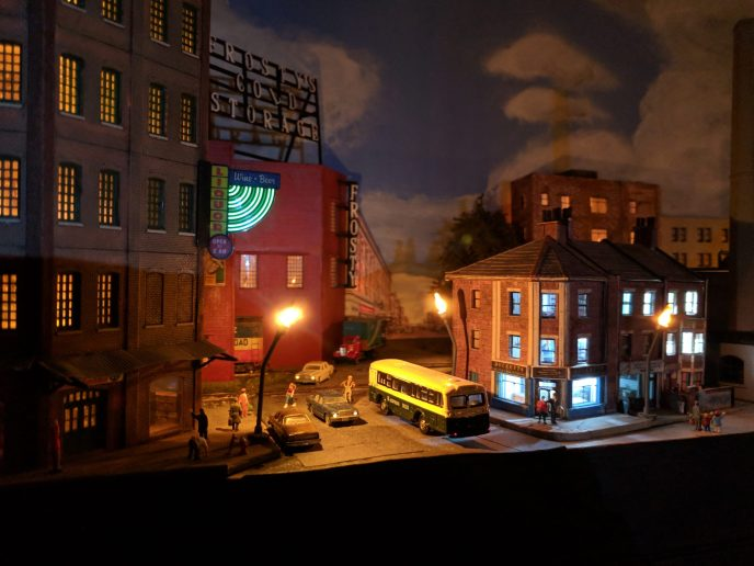 Night time at the town of Wrightsville- Notice N scale vehicles with headlights on