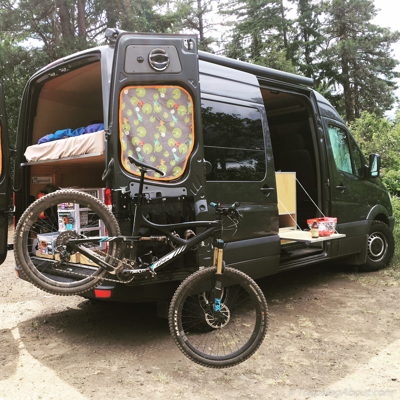 The adventure mobile our diy sprinter camper van bicycle hauler bike repair stand and side table showing their utility after a mtb ride solutioingenieria Images
