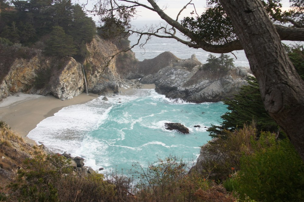 Nice blue bay in Julia Pffeifer Burns State Park, with McWay Falls pouring out of the cliff.
