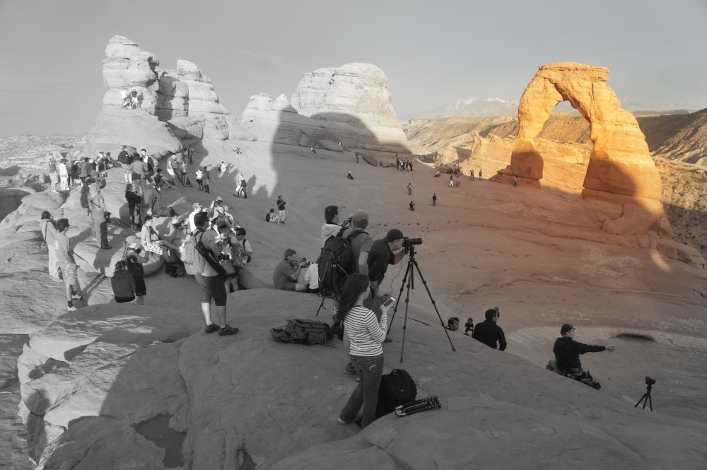 The many fans of Delicate Arch at sunset.