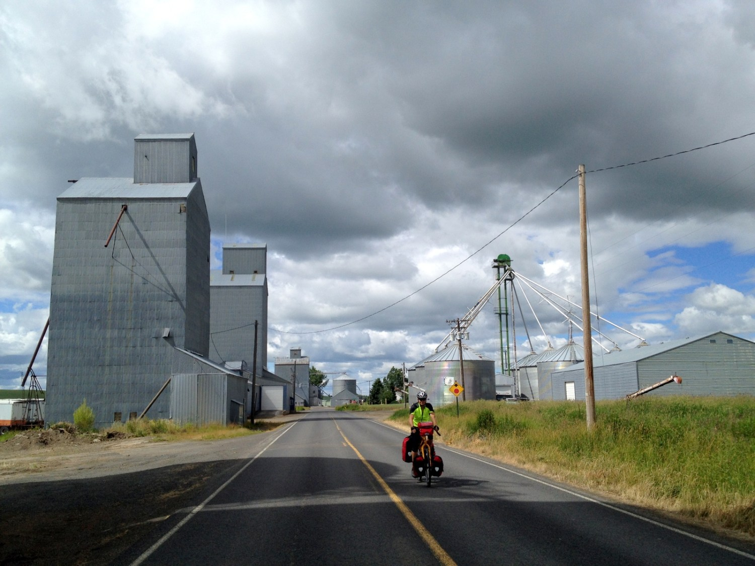 Riding between tall silos on the border of Idaho and Montana. (C photo)