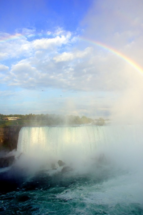 A full rainbow crests Horseshoe Falls at Niagara.