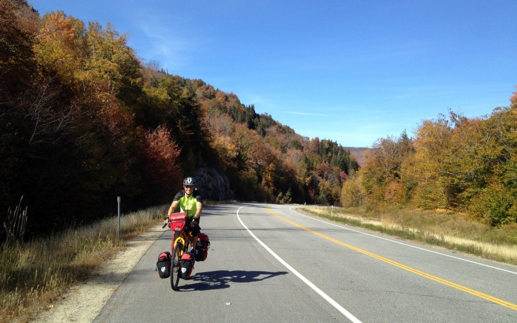 Dakota climbing in the White Mountains. Roads the way cyclists love them: low traffic and big shoulder under blue skies.