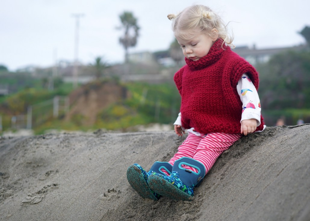 Joe and Ellee's daughter Ruby anticipates sliding down a sand dune.