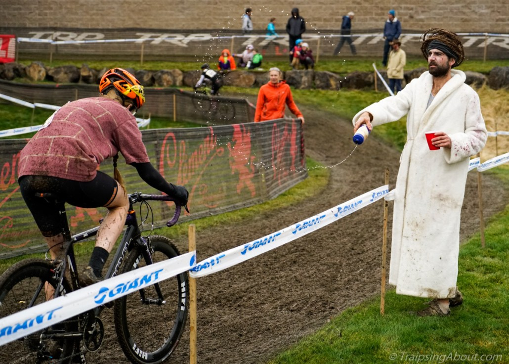 After his own race, Jesus grabbed a beer and flung water at each rider: May Cross be with you!