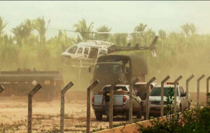 Army helicopters and trucks move in as part of the operation. © Globo TV