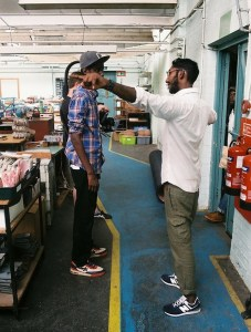 Professional Photography Black And Asian Man Discussing Filming In Grenson Shoe Factory With Cameraman