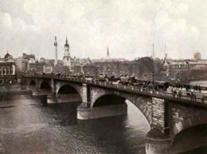 The old London Bridge spanning the River Thames in England