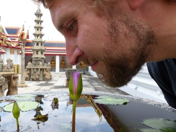 Christian smelling at a water lilly