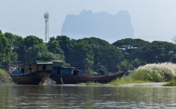 Boats with limestone rock backdrop on the river on our way to Hpa-An