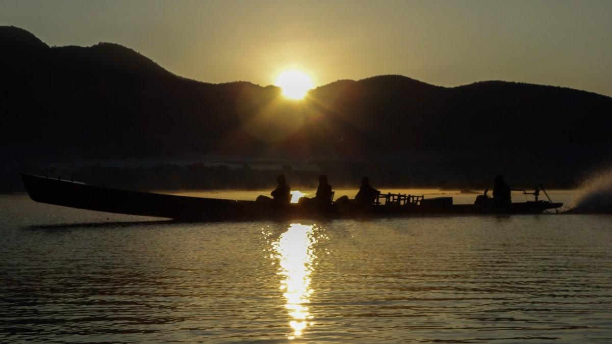 Longboats on Inle Lake at sunrise