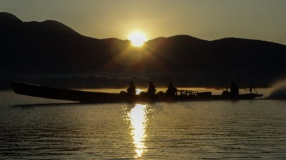 Longboats on Inle Lake at sunrise