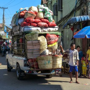 Overly full pickup truck at Zeigyi Market in Mawlamyine