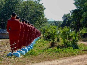 Line of hundreds of standing Buddhas infront of Win Sein Taw Ya