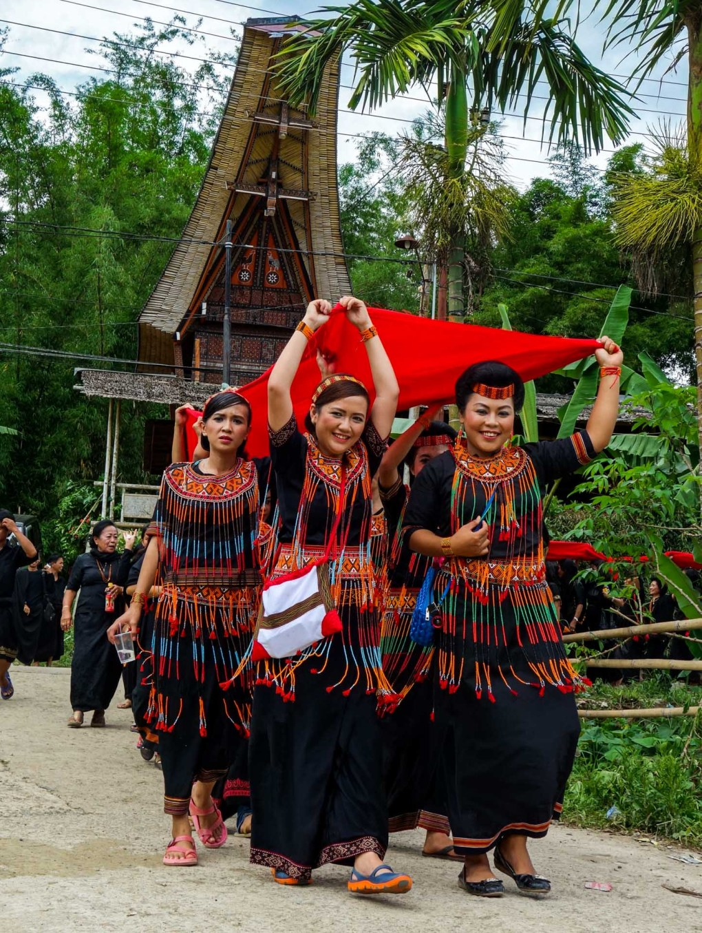 Tana Toraja Funeral Ceremony - granddaughters in traditional clothing at coffin parade through the village Christian Jansen & Maria Düerkop