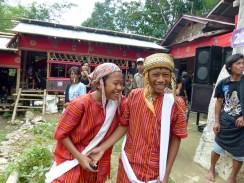 Tana Toraja Funeral Ceremony - grandsons in traditional clothes Christian Jansen & Maria Düerkop