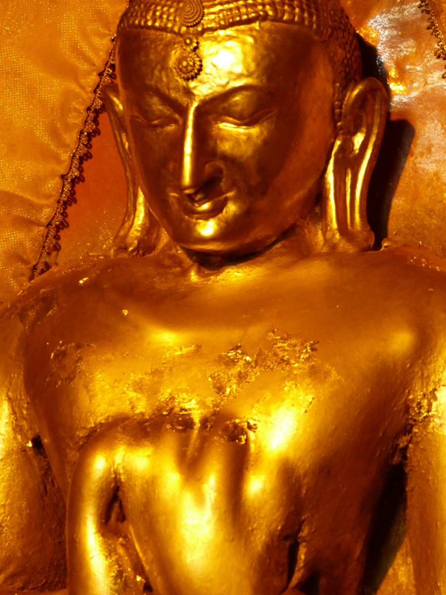Buddha with a large layer of gold leaf offerings - Bagan temple Christian Jansen & Maria Düerkop