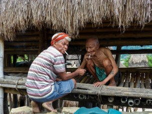 Sumba - village priest and old man sharing cigarettes Christian Jansen & Maria Düerkop