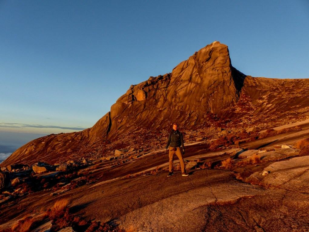 Mount Kinabalu - Chris in red sunrise Christian Jansen & Maria Düerkop