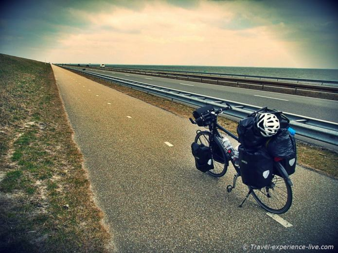 Cycling across the Enclosure Dam, Afsluitdijk, Netherlands.