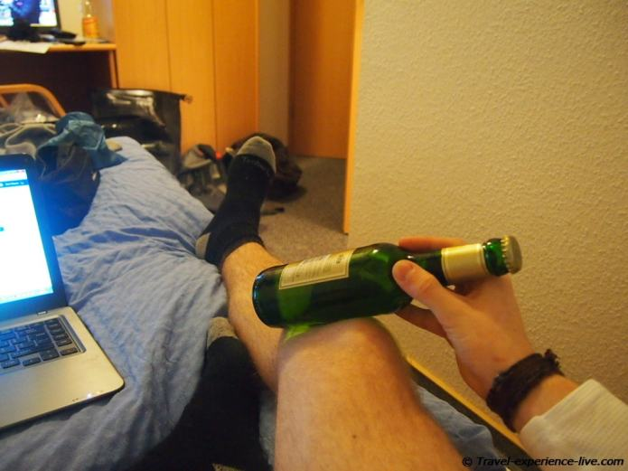 Treating injured knee with cold beer.