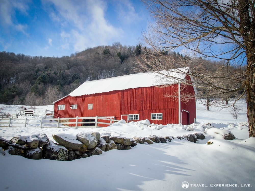 Red barn, white fields and blue skies in Vermont