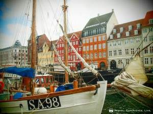Sailboats and colored houses in Nyhavn, Copenhagen, Denmark