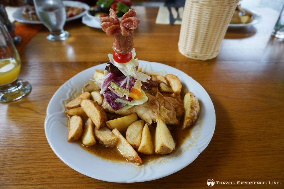 Slovenian Food: Pork, cheese, gravy and potato wedges
