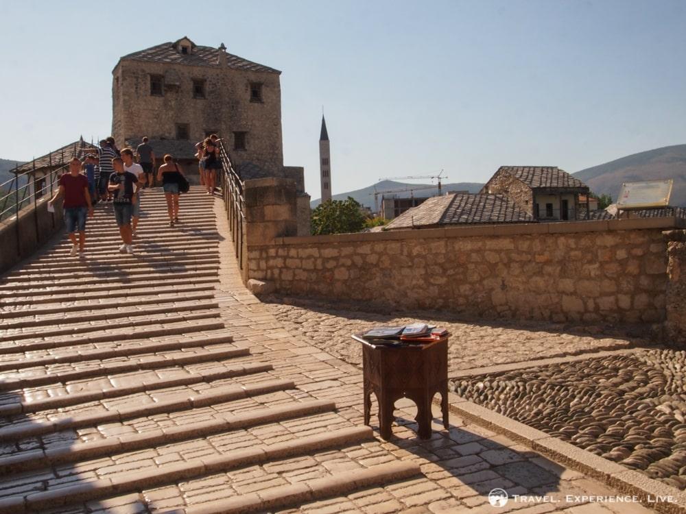 Walking across the Stari Most in Mostar